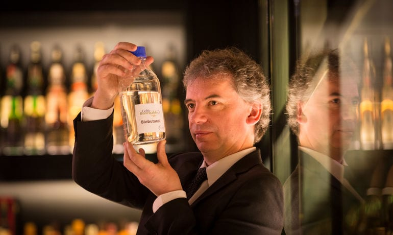 Martin holding a bottle of whiskey